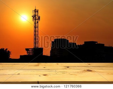 Large Antenna With The Sunset, A Wooden Table For Placing