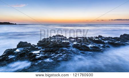 Long Exposure Of Rocky Seascape At Dawn