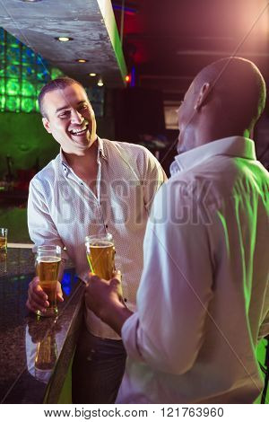Two men having beer at bar counter in bar
