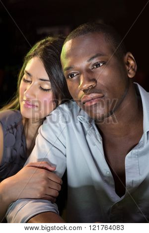 Close-up of young couple sitting together at bar