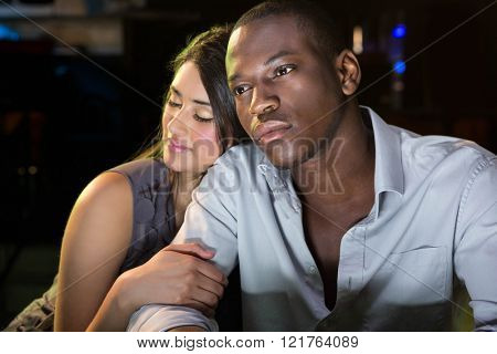 Young couple sitting together at bar