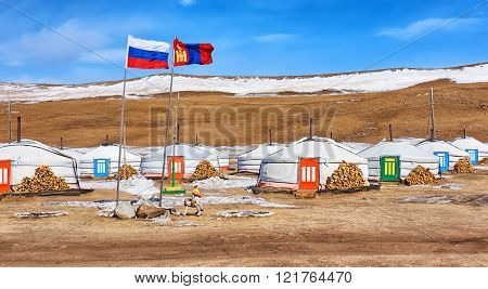 Russian And Mongolian Flag Next To Gers (yurts)