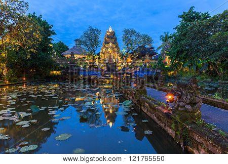 Pura Saraswati Temple with beatiful lotus pond at dusk before the dancing show Ubud Bali Indonesia