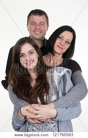 Portrait Of Happy Young Family With Daughter - On White Background