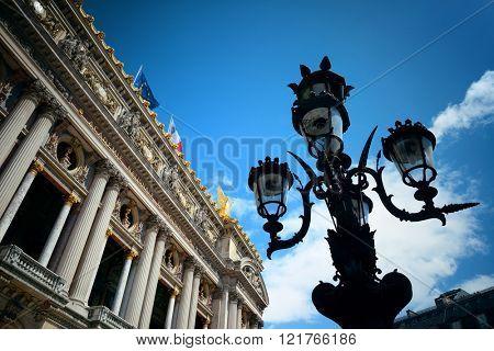 Palais Garnier with vintage lamp viewed from street in Paris.