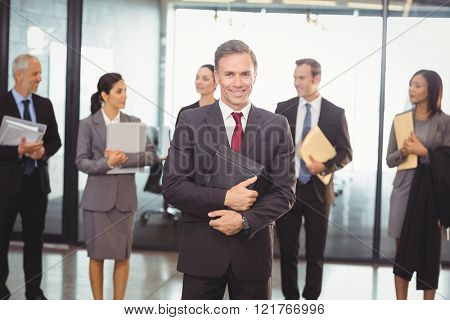 Portrait of business team with document and organizer in office