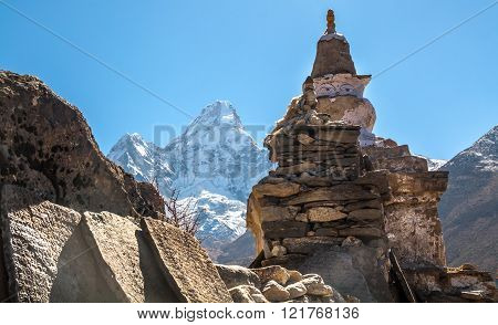 Buddhist Stupa And Prayer Stones In The Mountains On The Trail.