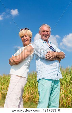 Senior couple enjoying sunny day and clear blue sky