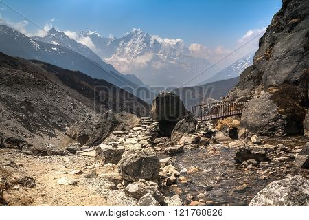 Mountain Trai  Intersecting A Small River On The Bridgel In The Gokio Valley.himalayas.
