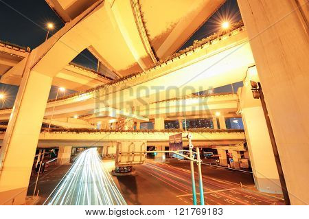Highway bridge in Shanghai with busy traffic at night.
