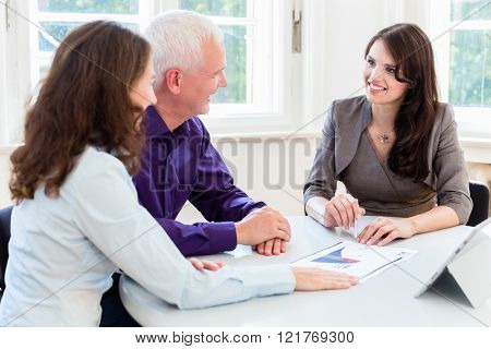 Senior woman and man at retirement financial planning with consultant or adviser