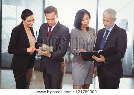 Team of business people interacting in the office