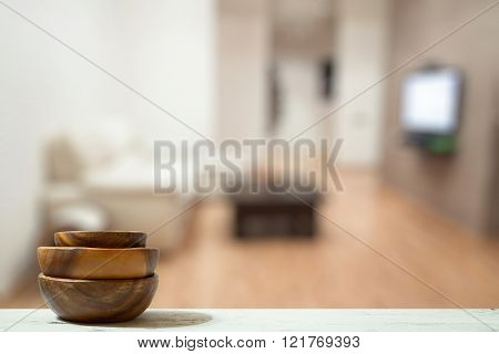 stack of empty wooden bowls old white table in the living room