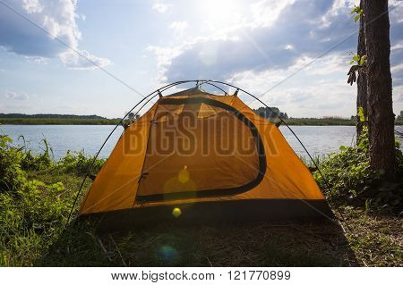 Tent camp in sunny morning lights. Beautiful sammer nature near river