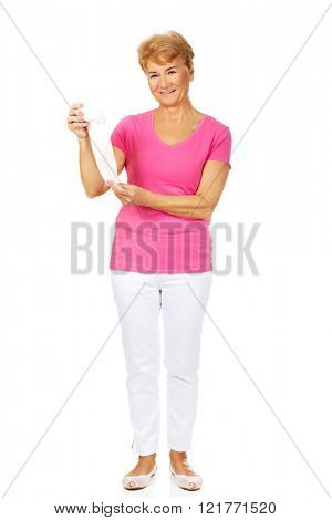 Smile senior woman holding bandage