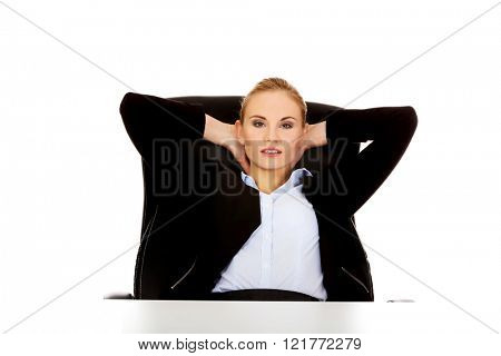 Happy business woman relaxing in office