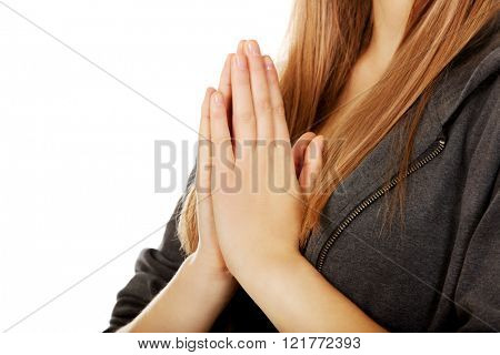 Teenage woman praying-religion concept