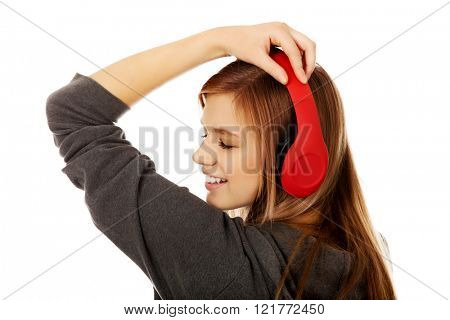 Teenage woman listening to music
