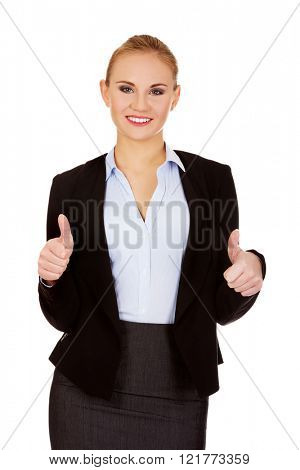 Young happy business woman with thumbs up
