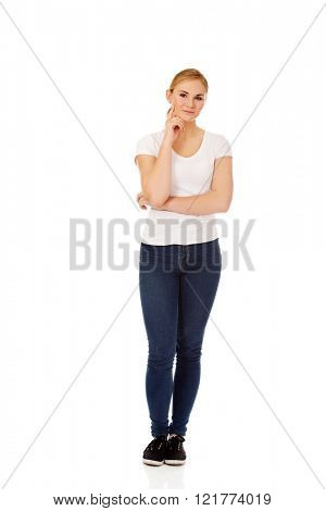 Young  woman with folded hands and finger on cheek