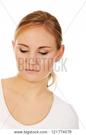 Young thoughtful and sad woman