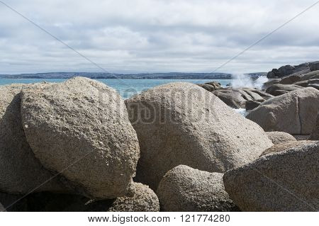 On the rocks of the coastal rocky granite shores of Port Elliot South Australia looking out to see.