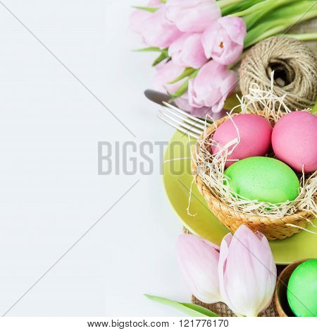 Basket With Easter Eggs  And Flowers