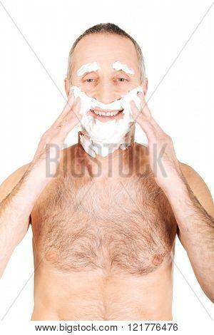 Man applying shaving foam