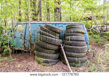 Stacks Of Tires By Old Blue Van