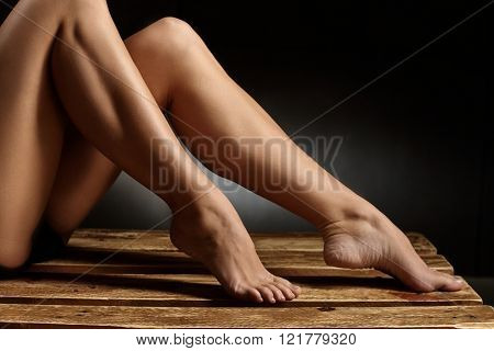 Closeup photo of naked legs of female dancer.