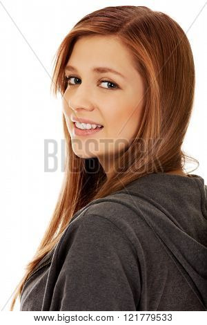 Teenage woman smiling in cheerful mood