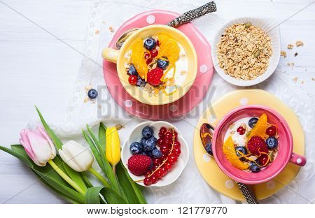 Healthy breakfast with muesli, yogurt and fresh berries in cup