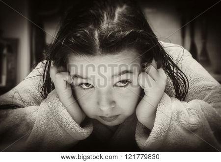 Little girl looks askance. Black and white photo
