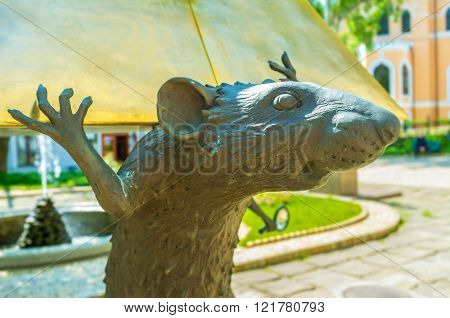 ODESSA UKRAINE - MAY 18 2015: The rat holding the pyramid is the element of the composition