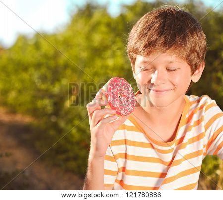 Boy biting cake