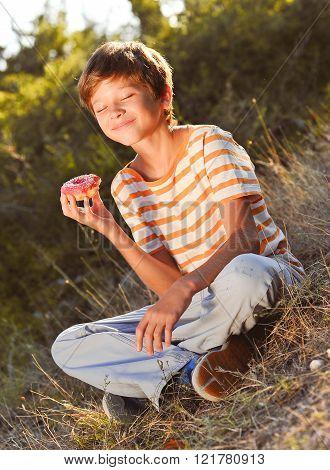 Happy boy eating cake