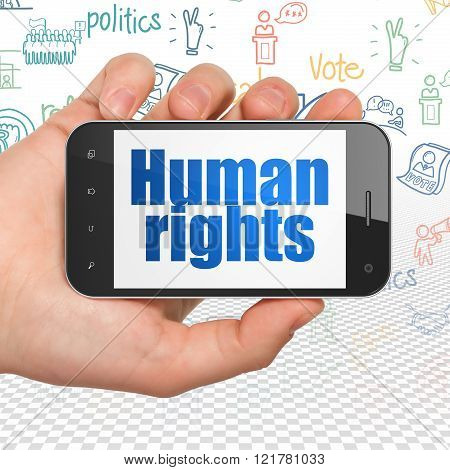Politics concept: Hand Holding Smartphone with  blue text Human Rights on display,  Hand Drawn Politics Icons background poster