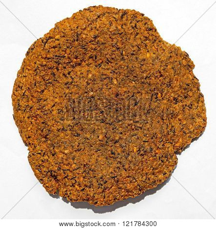 Flat vada or savouries made from Vigna mungo or Urad Dal along with its black outer cover
