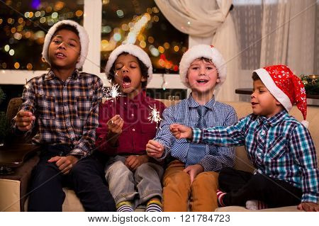 Four children sing Christmas song.