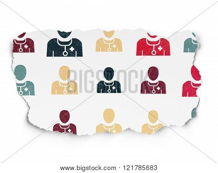 Healthcare concept: Doctor icons on Torn Paper background