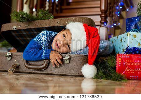 Curious black boy on Christmas.