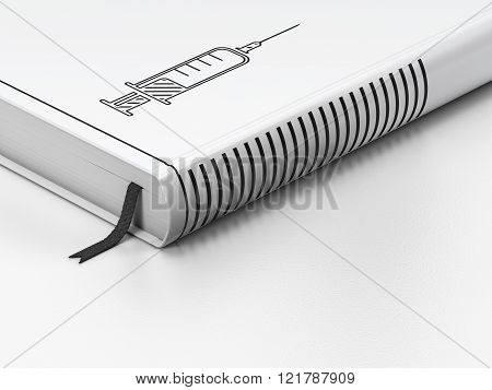 Health concept: closed book, Syringe on white background