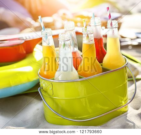 Bottles Of Lemonade Standing In Green Bucket