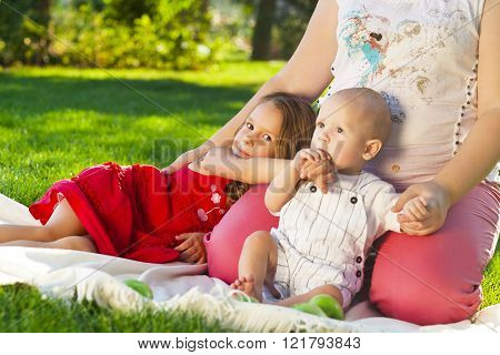 Mother And Her Kids Outdoors. Happy Mum And Her Children Playing In Park Together