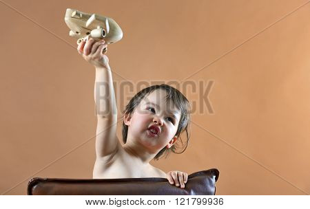 Happy Child Girl Playing With Toy Airplane