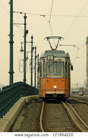 Budapest, Hungary - February 19, 2012: Yellow Tram Number 2 On The Route In Pest Part Of Budapest Ea