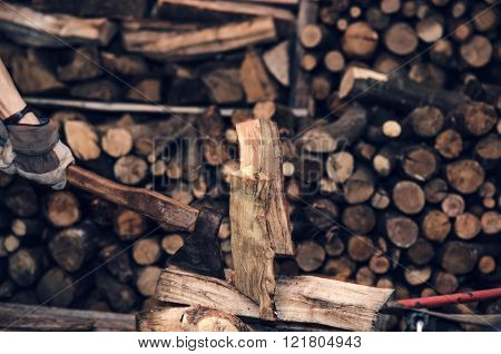 Man With An Ax Near Firewood Stock