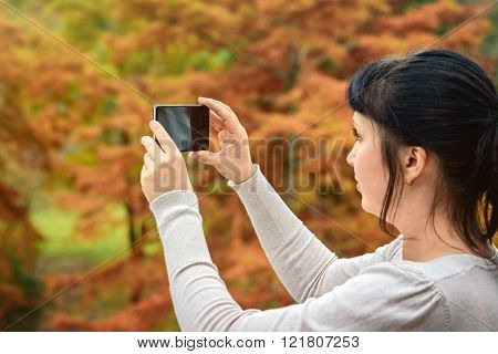 Woman Taking Pictures With Mobile Phone