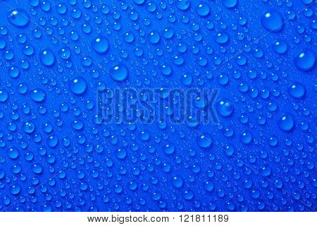 beautiful fresh Water Drops On Blue Background