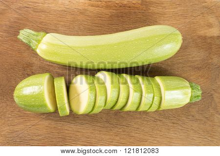 Cut Zucchinis Isolated On A Wooden Background